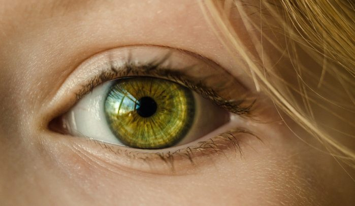 Close-up-of-blonde-woman's-green-eye
