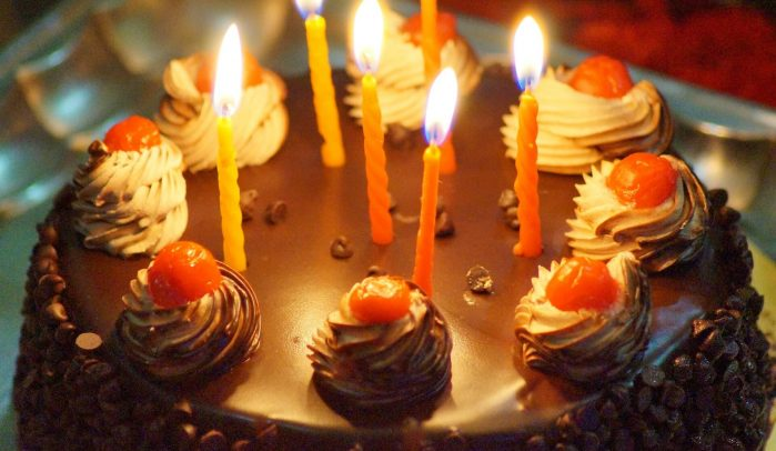 Black-forest-cake-with-lit-birthday-candles