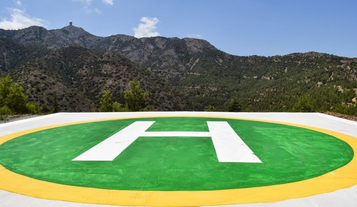 Green-helipad-in-front-of-mountains