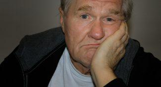 Bored-senior-man-resting-head-on-hand