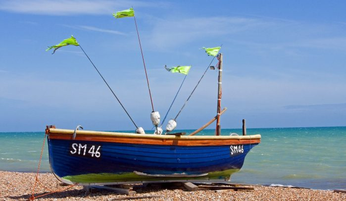 Small-blue-fishing-boat-on-the-beach