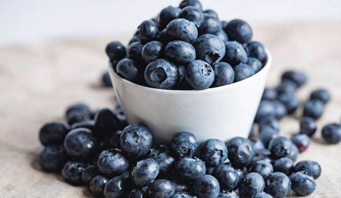 White-bowl-overflowing-with-blueberries