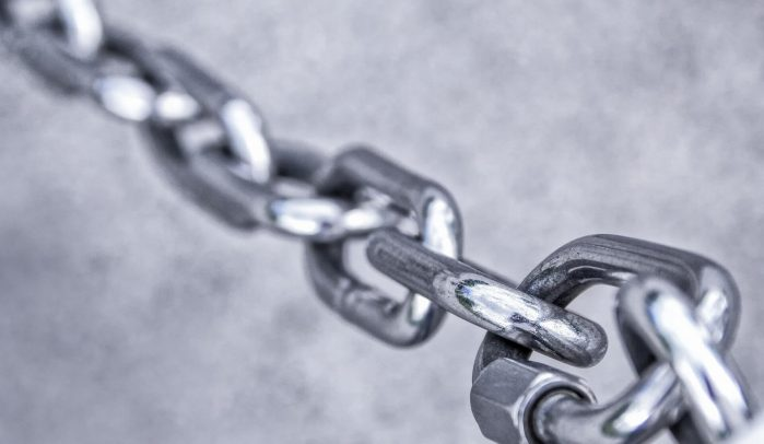 Stainless-steel-chain-on-grey-background