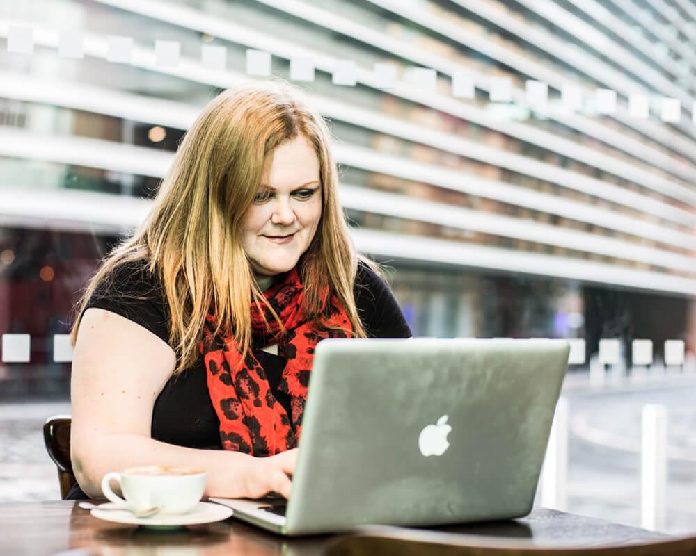 Jenny-Lucas-researching-using-Mac-laptop