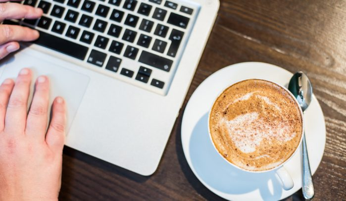 Laptop-keyboard-and-cappuccino-from-above