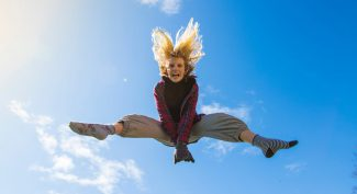 Girl-jumping-high-in-the-sky