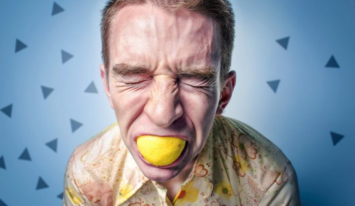 Pained-man-sucking-on-lemon