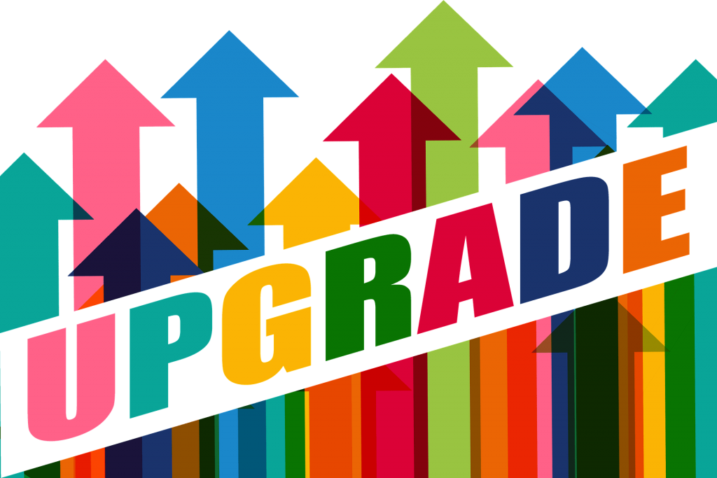 The-word-upgrade-against-backdrop-of-colourful-upward-arrows