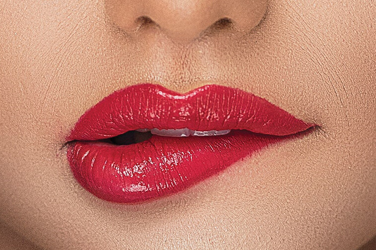 Woman's-mouth-with-red-lips-biting-lip